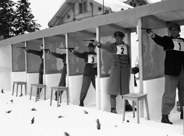 Shooting in the pistol section of the Olympic Pentathlon competition, from right to left is Sdt. Griessler of Austria, Capt. John Walker of Gt. Britain, Hptmn. Scriber, Feb. 1, 1948, St. Moritz, Switzerland. (AP Photo/J. Walter Green)