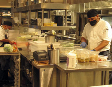 Kitchen workers prepare food in a restaurant inside the Hard Rock casino in Atlantic City N.J. on Sept. 1, 2020. (AP Photo/Wayne Parry)