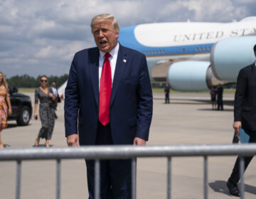 President Donald Trump talks to a crowd of supporters after arriving at Wilmington International Airport, Wednesday, Sept. 2, 2020, in Wilmington, N.C. (AP Photo/Evan Vucci)