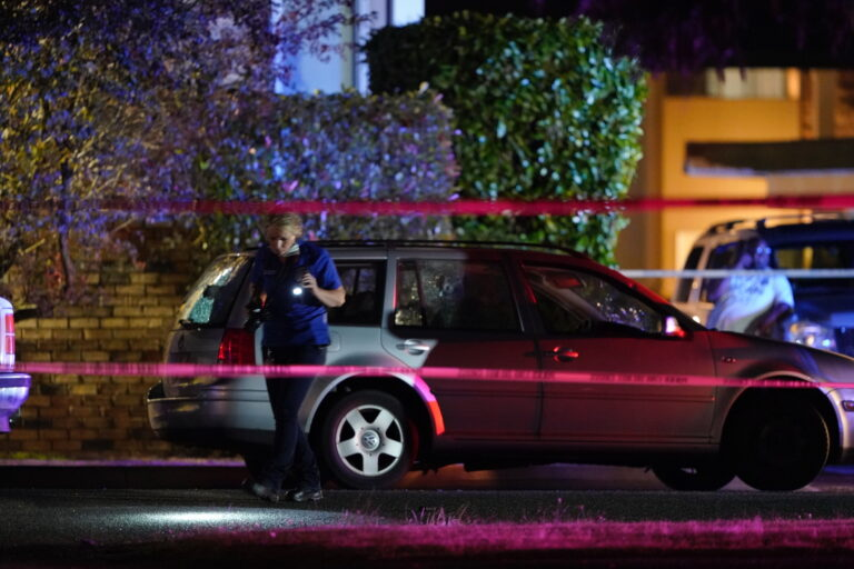 An investigator works at a scene where a man suspected of fatally shooting a supporter of a right-wing group in Portland, Ore., last week was killed as investigators moved in to arrest him in Lacey, Wash., Thursday, Sept. 3, 2020. Michael Reinoehl, 48, was killed as a federal task force attempted to apprehend him in Lacey, a senior Justice Department official said. (AP Photo/Ted Warren)