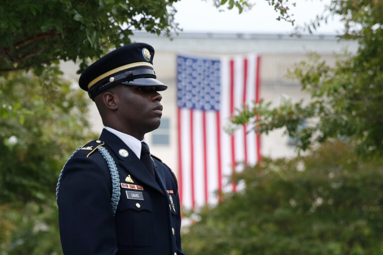 In this Sept. 11, 2019 file photo, a member of the U.S. Army Old Guard stands on the grounds of the National 9/11 Pentagon Memorial before a ceremony in observance of the 18th anniversary of the September 11th attacks at the Pentagon in Washington. (AP Photo/Patrick Semansky)