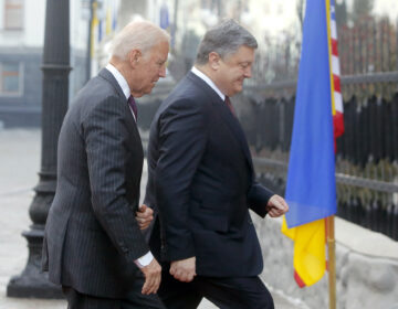 U.S. Vice President Joe Biden, left, and Ukrainian President Petro Poroshenko go  for talks during Biden's visit  in Kiev, Ukraine,  Monday, Jan. 16, 2017.  (AP Photo/Efrem Lukatsky)