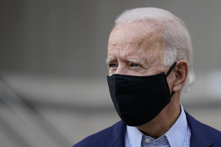 Democratic presidential candidate and former Vice President Joe Biden departs after voting early in Delaware's state primary election at the New Castle County Board of Elections office in Wilmington, Del., Monday, Sept. 14, 2020. (AP Photo/Patrick Semansky)