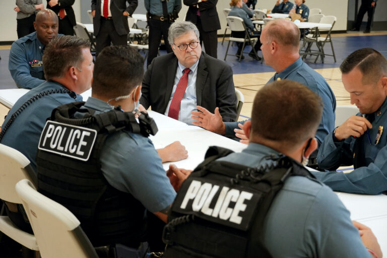 Attorney General William Barr participates in a roll call with police officers from the Kansas City Police Department