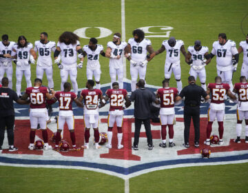 Eagles and Washington players link arms in a show of unity