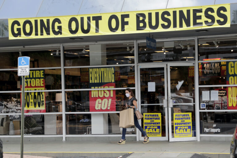 A customer leaves a Pier 1 retail store, which is going out of business