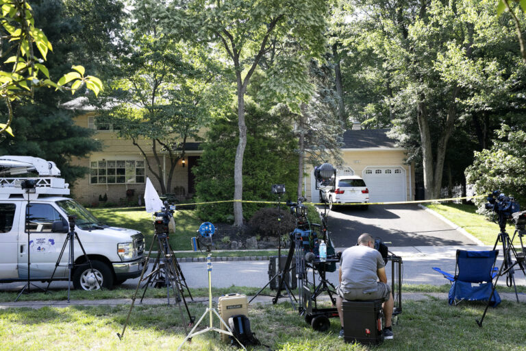News media is set up in front of the home of U.S. District Judge Esther Salas