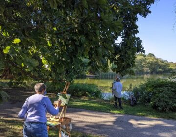 Two woman paint overlooking the lake at FDR Park. (Courtesy Friends of FDR Park)