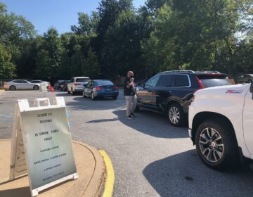 The line of cars waiting for a drive-up COVID-19 test at this Walgreens near Claymont snaked into the street. (Cris Barrish/WHYY)