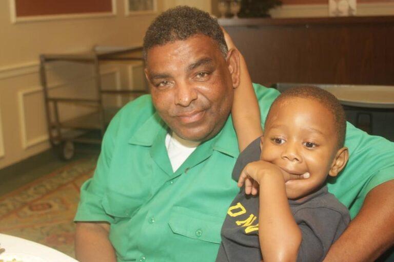 Malik Aziz with his grandson. (Photo courtesy of Aziz family)