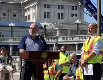 Former Pa. State Police Sgt. Bob Bemis speaks at a rally supporting increased penalties for those who fail to comply with the state's Steer Clear law. At right, state Sen. Doug Mastriano (R, Adams County) (Sam Dunklau/WITF)