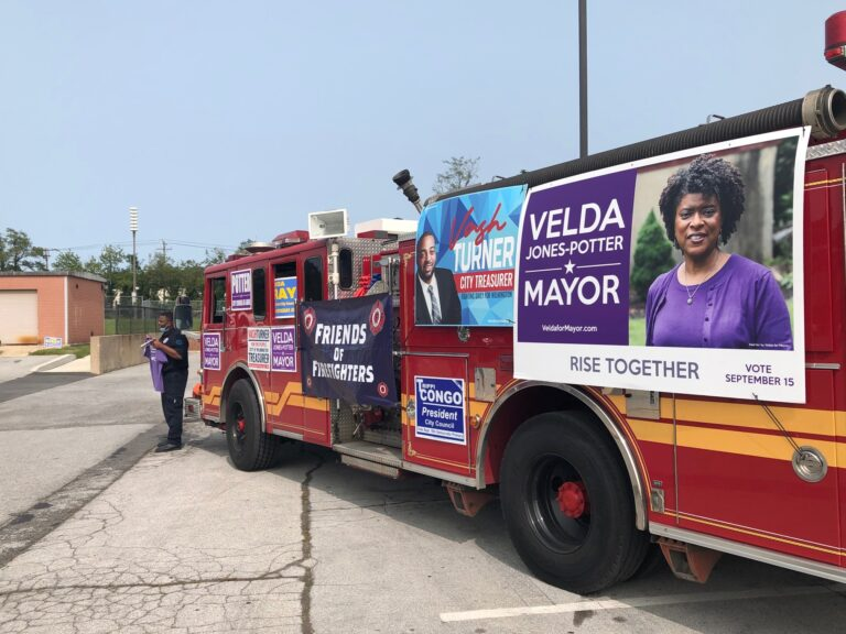 Members of the Wilmington firefighters' union came out in force for mayoral hopeful Velda Jones-Potter and other city candidates Tuesday. (Cris Barrish/WHYY)