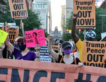 Anti-Trump protesters take to the streets after a rally at Independence Mall. (Emma Lee/WHYY)