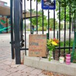 A memorial to five people shot on a basketball court, two fatally, stands at the entrance to Roberto Clemente Playground. (Emma Lee/WHYY)