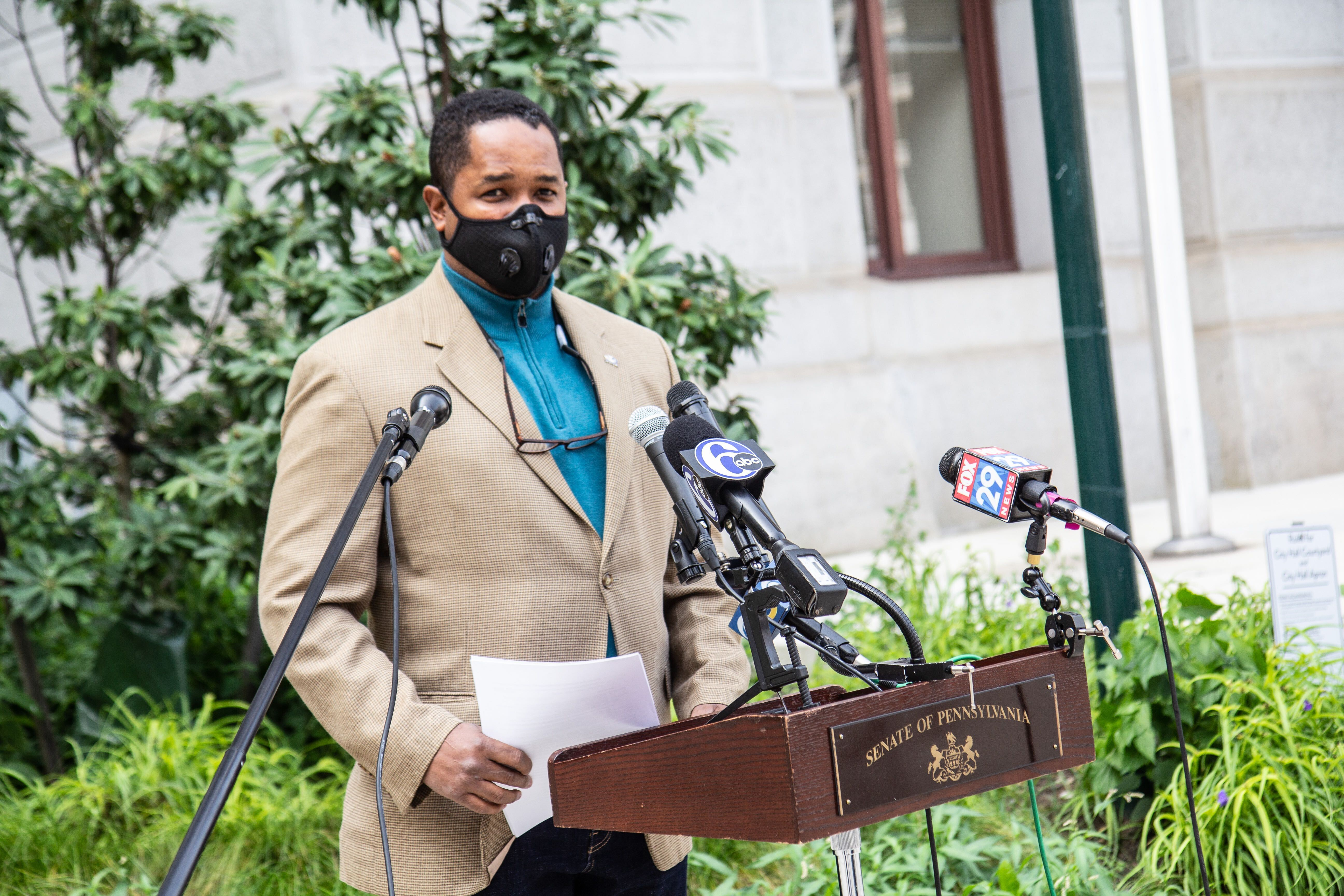 Pennsylvania State Sen. Sharif Street speaks from behind a podium