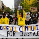 """Protesters march up 33rd Street in Philadelphia's University City chanting """"Justice for Breonna Taylor."""" (Kimberly Paynter/WHYY)"""