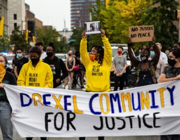 "Protesters march up 33rd Street in Philadelphia's University City chanting ""Justice for Breonna Taylor."" (Kimberly Paynter/WHYY)"