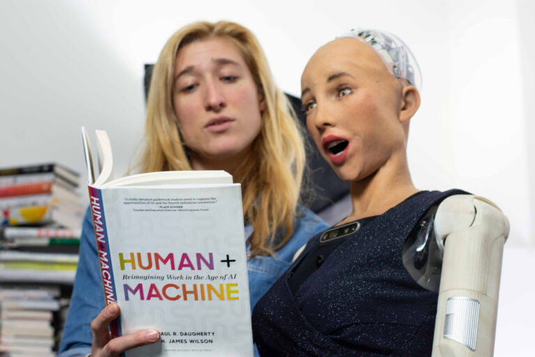 Sarah Rose Siskind reads a book to Sophia the Robot, an interviewer, guest speaker and host with over 16,000 YouTube subscribers. (Image courtesy of Nikki Thomas)