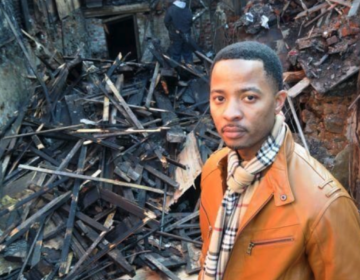 Elena's Soul Food owner Algernong Allen III stands in front of his restaurant in 2013, after it was destroyed by fire. (Abdul R. Sulayman/The Philadelphia Tribune)