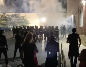 Lancaster police deployed tear gas on a crowd of people protesting early Monday after an officer shot and killed a man while responding to a domestic disturbance call.