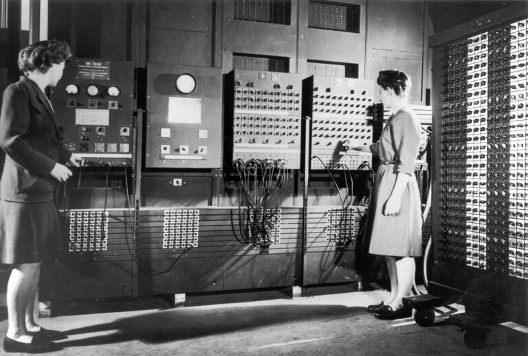 Two women operating the ENIAC's main control panel while the machine was still located at the Moore School. Left: Betty Jennings (Mrs. Bartik) Right: Frances Bilas (Mrs. Spence) setting up the ENIAC. (United States Army/Public domain)