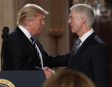 President Trump shakes hands with Neil Gorsuch, his first pick for a spot on the U.S. Supreme Court, on Jan. 31, 2017. The president will likely have the opportunity to name a replacement for Justice Ruth Bader Ginsburg, who died Friday. (Carolyn Kaster/AP Photo)