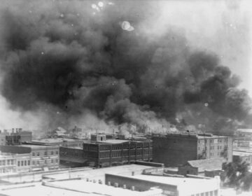In this 1921 image provided by the Library of Congress, smoke billows over Tulsa, Okla., the scene of one of the nation's most brutal race massacres. (Alvin C. Krupnick Co./AP)