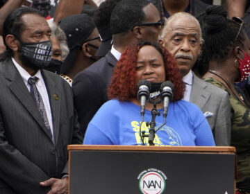 Tamika Palmer spoke at the March on Washington last month at the Lincoln Memorial in Washington, D.C. At left is Rep. Al Green, D-Texas, and at right is Rev. Al Sharpton. (Jacquelyn Martin/AP Photo)