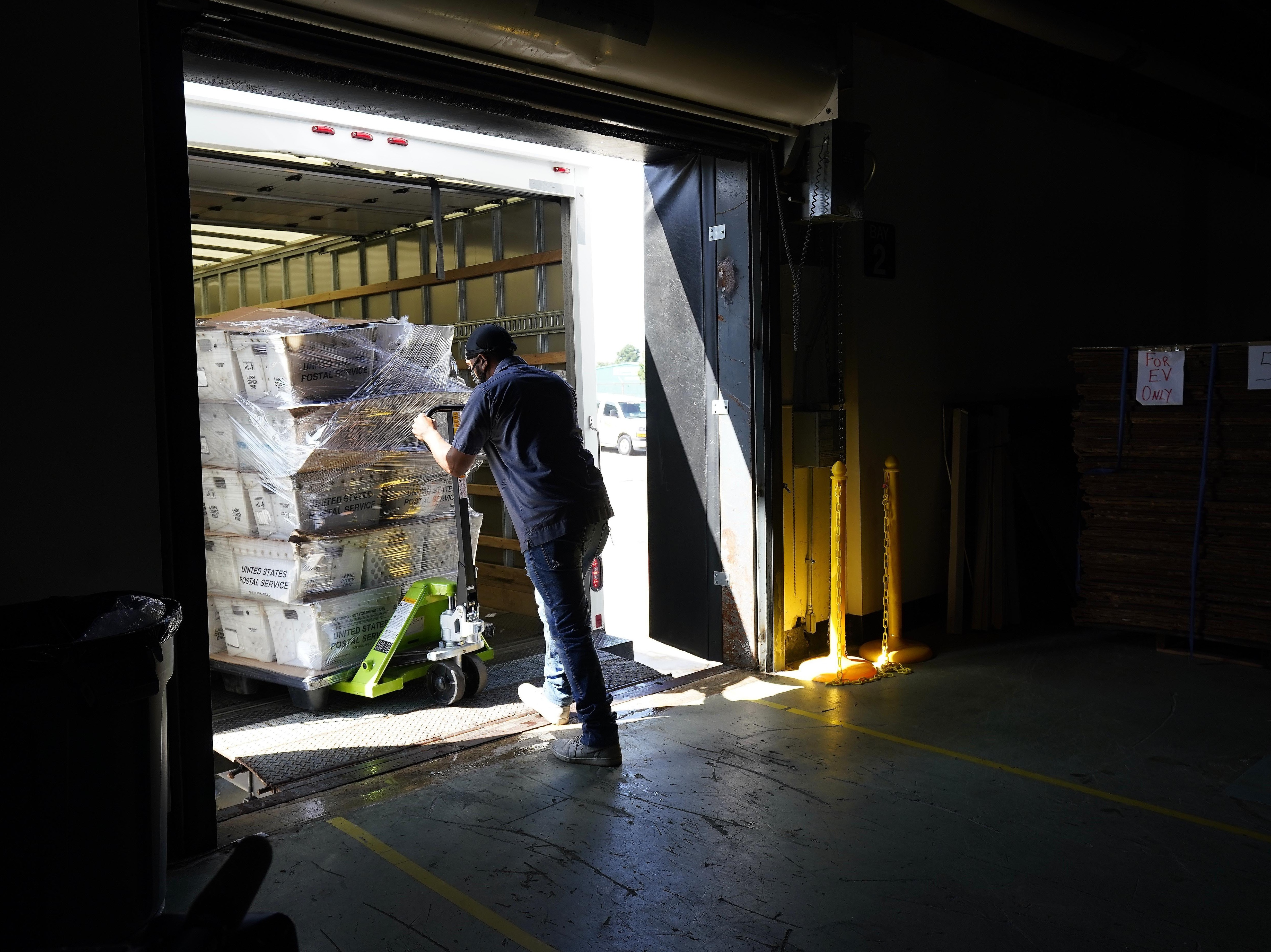 Absentee ballots are loaded onto a truck for mailing earlier this month at the Wake County, N.C., Board of Elections.