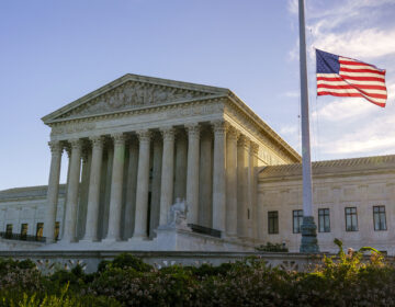The flag flies at half-staff Saturday at the Supreme Court on the morning after the death of Justice Ruth Bader Ginsburg. (J. Scott Applewhite/AP Photo)