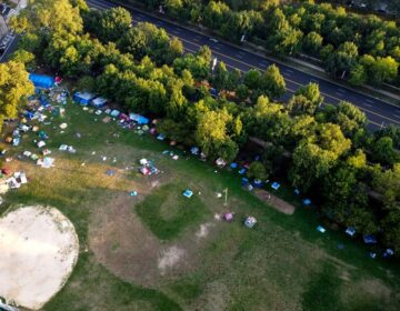 The encampment at Von Colln Field on the Ben Franklin Parkway, seen from above in late July. (Mark Henninger/Imagic Digital)