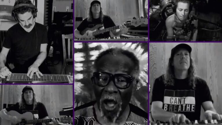 A black and white screenshot of musicians performing a song virtually through Zoom