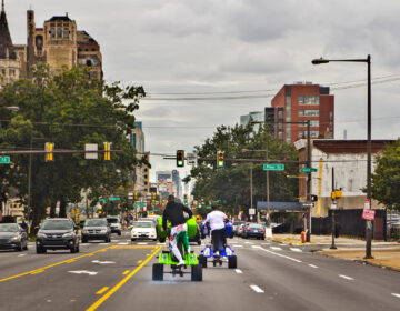 Young people riding ATVs through the streets of Philly. (Kimberly Paynter/WHYY)