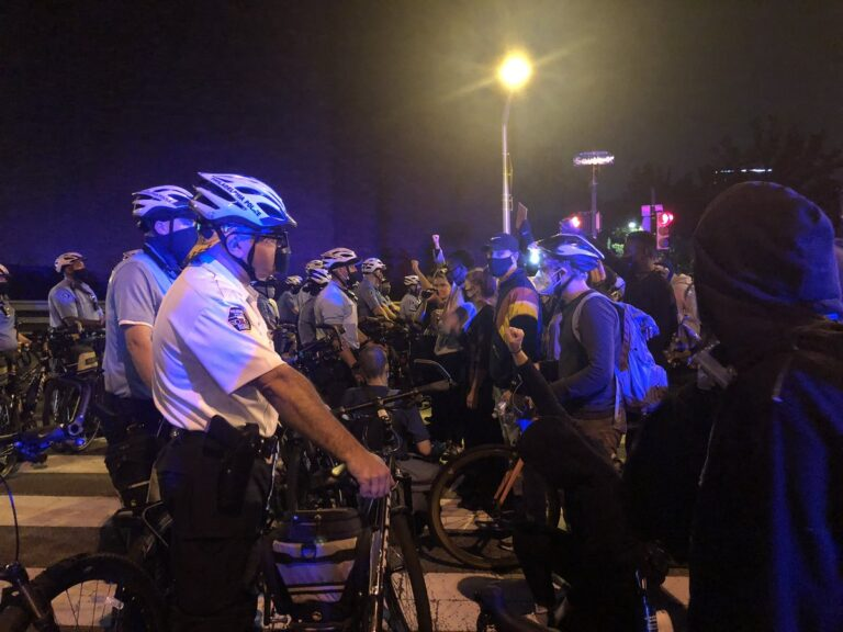 Protests are stopped at South Street Bridge by Philadelphia Police on the second night of protests after a grand jury's decision in the Breonna Taylor case. (Joe Hernandez/WHYY)