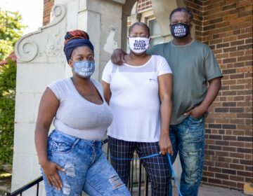 From left, Heavenly, Stephanie and Robert and Pettigrew are seen outside their two-bedroom rental apartment in Milwaukee