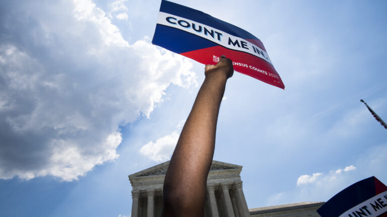 Protesters hold signs about the 2020 census at a rally in front of the U.S. Supreme Court in Washington, D.C., in 2019. (Bill Clark/CQ Roll Call via Getty Images)