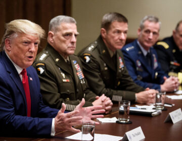 Chairman of the Joint Chiefs of Staff Army Gen. Mark A. Milley (second from left) and others listen as President Trump speaks during a meeting with senior military leaders on Oct. 7, 2019. (Brendan Smialowski/AFP via Getty Images)