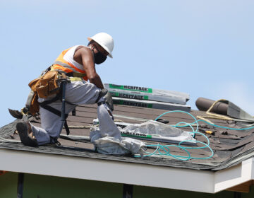 A construction worker roofs an apartment complex in Uniondale, N.Y., on May 27. U.S. employers added fewer jobs last month even as the unemployment rate fell to 8.4%. (Al Bello/Getty Images)