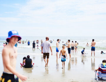 People roamed the beach in Ocean City, N.J, at the start of August. As Labor Day weekend arrives, Dr. Anthony Fauci, director of the National Institute of Allergy and Infectious Diseases, says Americans should remain vigilant to avoid another surge in coronavirus infection rates. (Gabby Jones/Bloomberg via Getty Images)