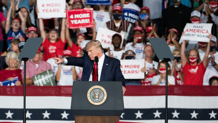 President Trump addresses the crowd during a campaign rally Tuesday at Smith Reynolds Airport in Winston Salem, N.C. (Sean Rayford/Getty Images)