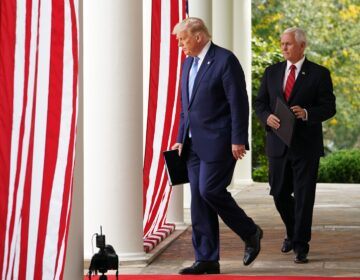 President Trump and Vice President Mike Pence make their way to the Rose Garden to speak on COVID-19 testing at the White House Monday.