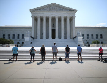 Anti-abortion demonstrators pray in front of the U.S. Supreme Court July 8, a day the court ruled that employers with religious objections can decline to provide contraception coverage under the Affordable Care Act. With the death of Ruth Bader Ginsburg, the ACA's future is in doubt.