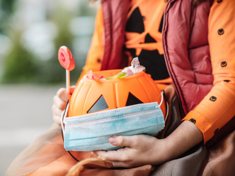 The Centers for Disease Control and Prevention's guidelines for a safe Halloween during the COVID-19 pandemic include new methods of doing classic spooky activities. (ArtMarie/Getty Images)