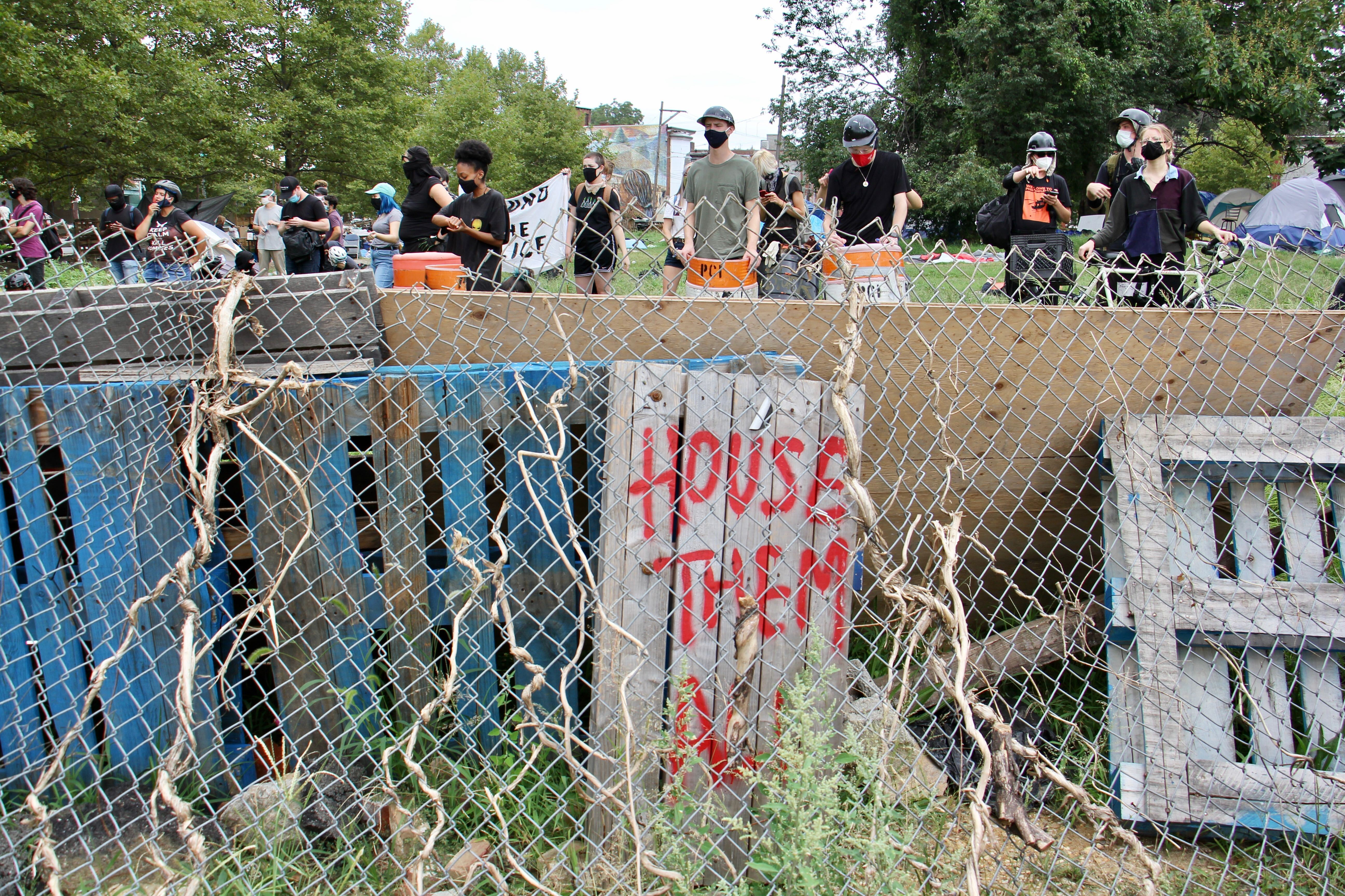Protesters defend a homeless encampment on Ridge Avenue
