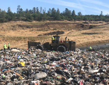 Landfill workers bury all plastic except soda bottles and milk jugs at Rogue Disposal & Recycling in southern Oregon. (Laura Sullivan/NPR)