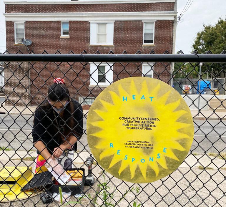 Jenna Robb distributes postcards in Grays Ferry. (Courtesy of Jenna Robb)