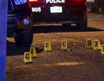 Evidence markers identified dozens of shell casings left outside the house on Delafield Street