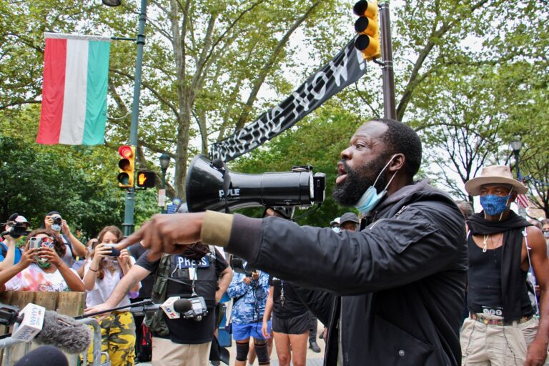 Anthony Lloyd, a resident of the homeless encampment on the Ben Franklin Parkway challenges the city's order to clear the camp. (Emma Lee/WHYY)