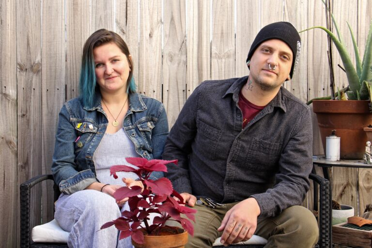 Melissa Durko and Drew Heaton sit in the backyard of their South Philadelphia rowhouse