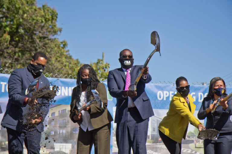 Pa. State Representative Donna Bullock (right), Mosaic Development Partner Leslie Smallwood-Lewis (second from right), PHA CEO Kelvin Jeremiah (center), executive director of the Brewerytown Sharswood Community Civic Association Darnetta Arce (second from left) and Pa. State Senator Sharif Street (left) ceremoniously broke ground on the new Sharswood Ridge development in Philadelphia. (Kimberly Paynter/WHYY)